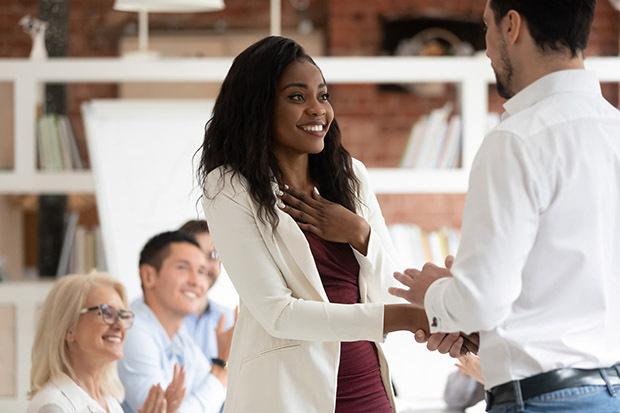 female employee gets rewarded