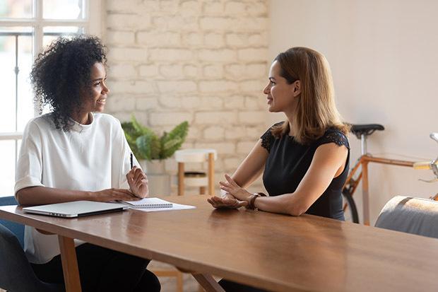 women talking during interview