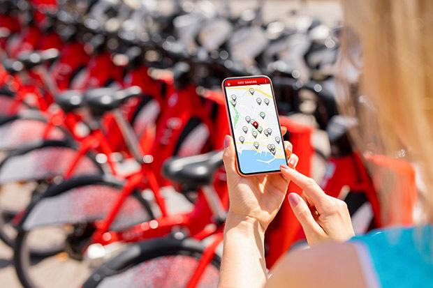 person using bike rental app