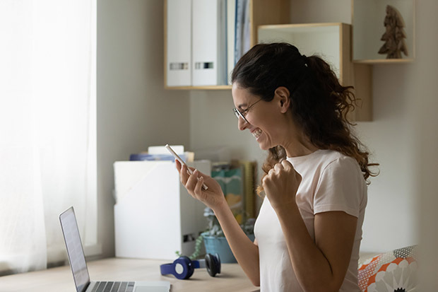 excited woman on mobile