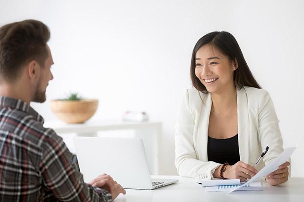smiling HR woman talking to employee