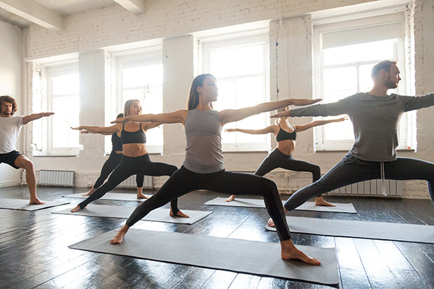 Group of people doing yoga in the studio