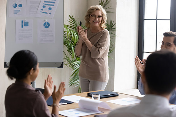 Smiling business woman conducting meeting