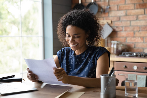 smiling woman reading document