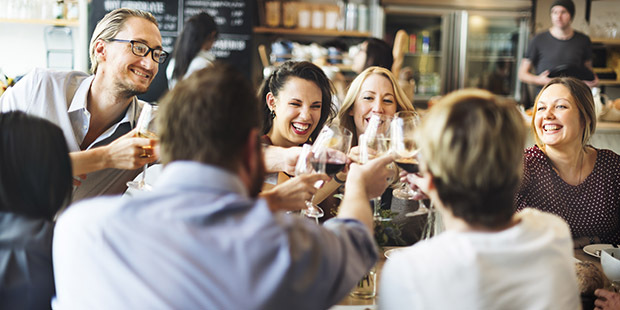 people celebrating with wine