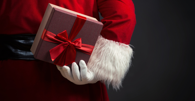 Santa holding a present behind his back
