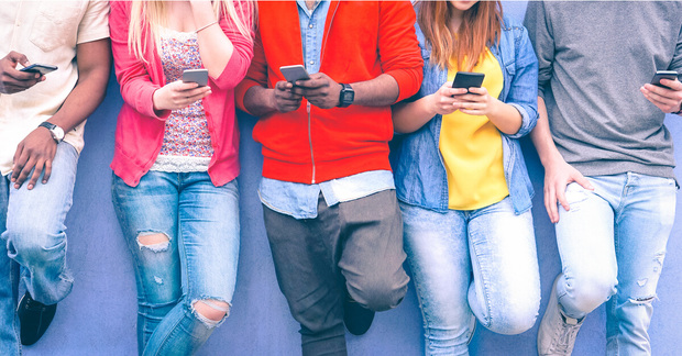 Group of people use their smartphones