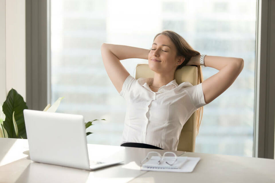 woman taking a break from her computer