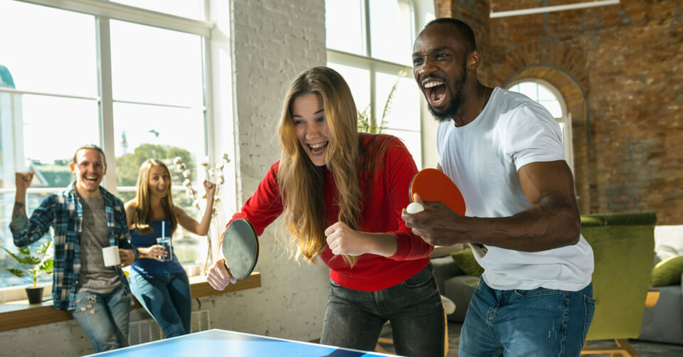 two people playing pingpong