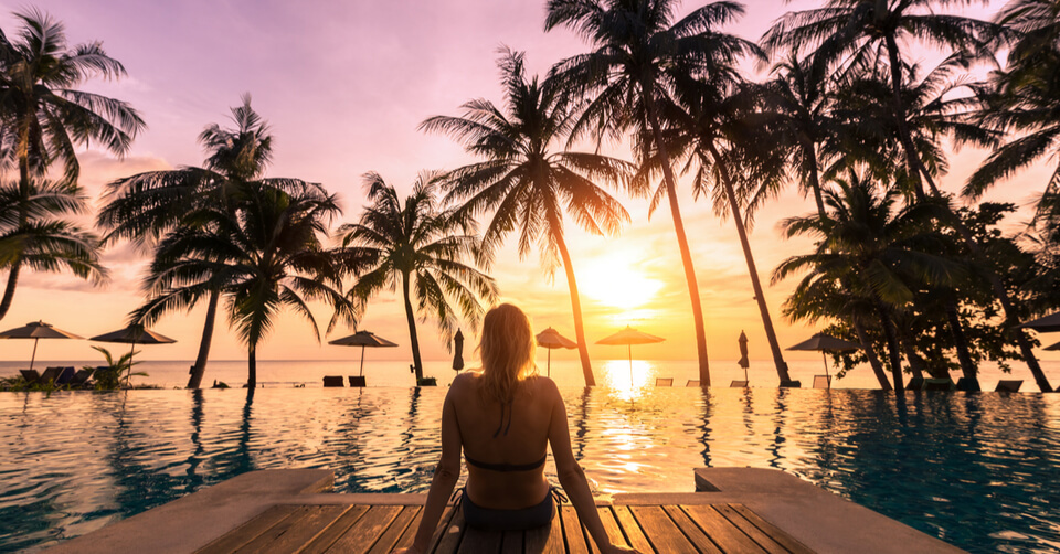 Woman on holiday looking at sunset