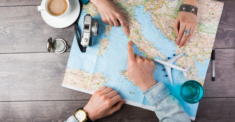 Man looking at a map of the world