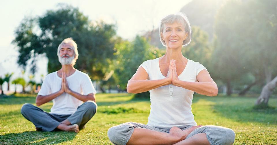older people doing yoga