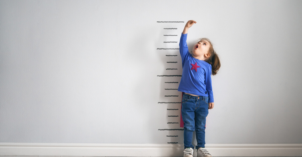 child measuring their height