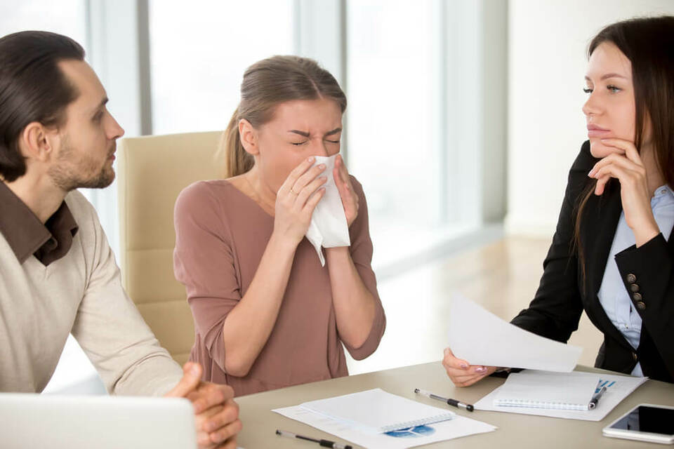 someone being ill while talking to colleagues