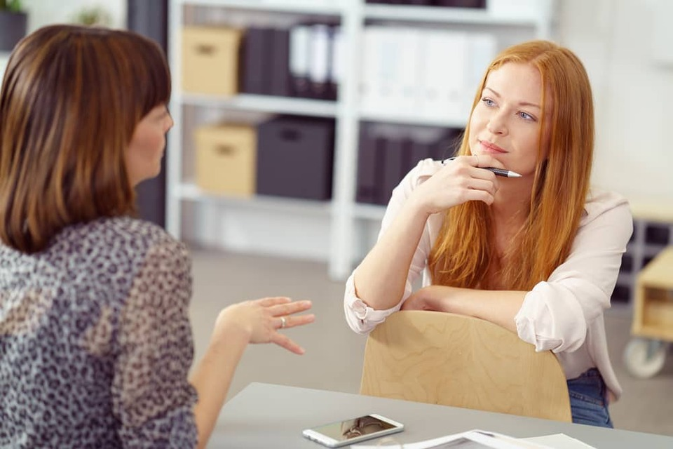 manager listening carefully to employee