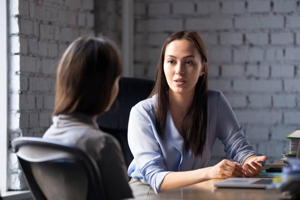 woman providing feedback to colleague